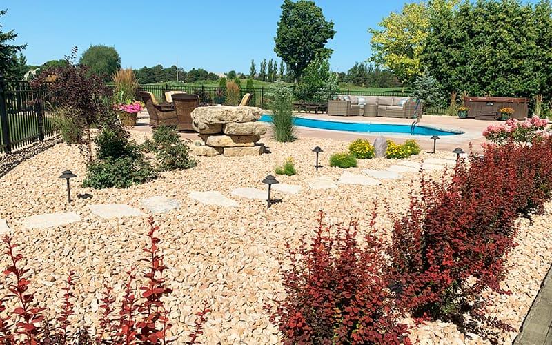 decorative stone garden bed near pool