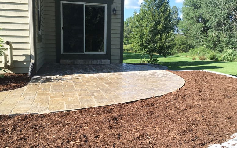 Paver sidewalk and mulch bed by Brinkmann Construction